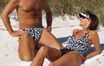 Accent Men's thong swimsuit shown here with Brigite in her coordinating Accent Rouge Tankini