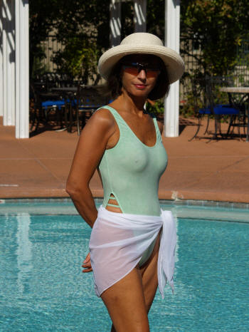 The Brigitewear Breezy sheer one piece swimsuit shown here with the optional coordinating Sheer White Sarong cover-up