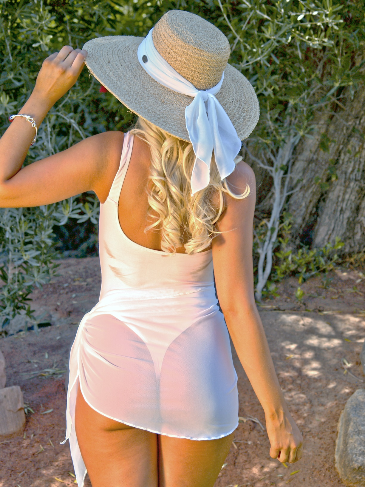 Sheer Elegance with our White Sheer Sarong . The equally sultry Sheer
