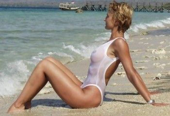 Camille wearing a White Sheer 2Scoops bathing suit on the beach in France