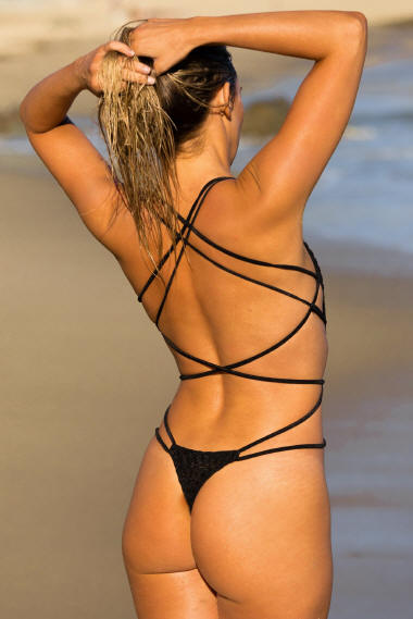 Seductive strapping on the Aphrodisiac one piece thong swimsuit