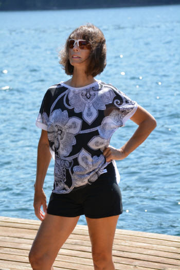 Sheer women's top worn with Brigitewear Sport Shorts
