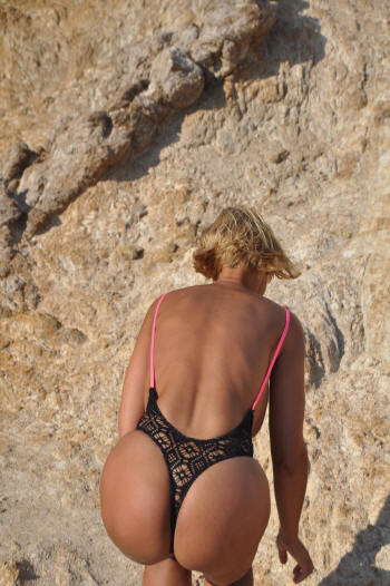 Extreme high cut legs on this one piece topless thong bathing suit