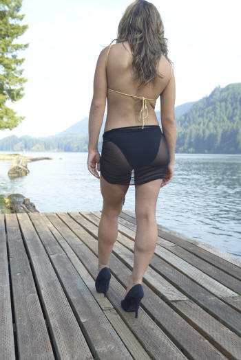 Carmen wearing Black/Gold Diamon swimsuit Rio bottom with Sheer Black sarong cover