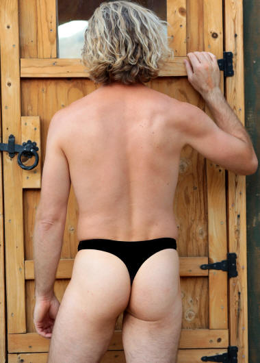 Men's Low Rider Thong swimsuit in black, back view