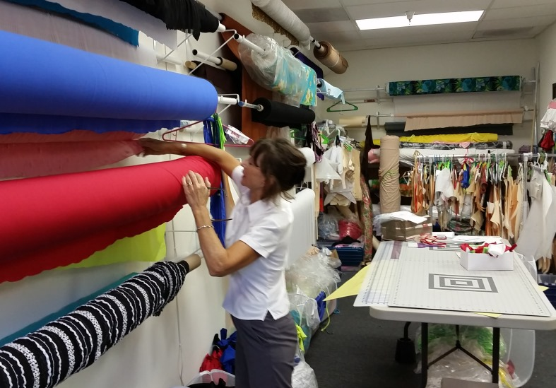 brigite selecting fabric for new swimwear at brigitewear's california production facility